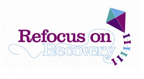 Photo of the refocus on recovery - the words with a blue and purple kite to the right