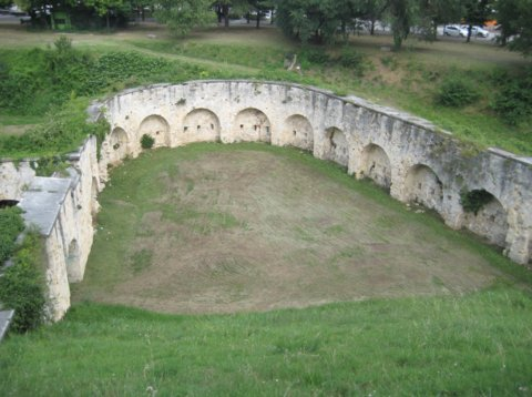 Photo of a historic wall surrounding a grassy area, taken by Kelvin Felix as part of the project