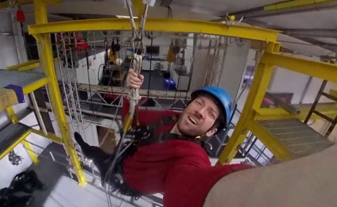 Photo of Andrew installing a camera for his research