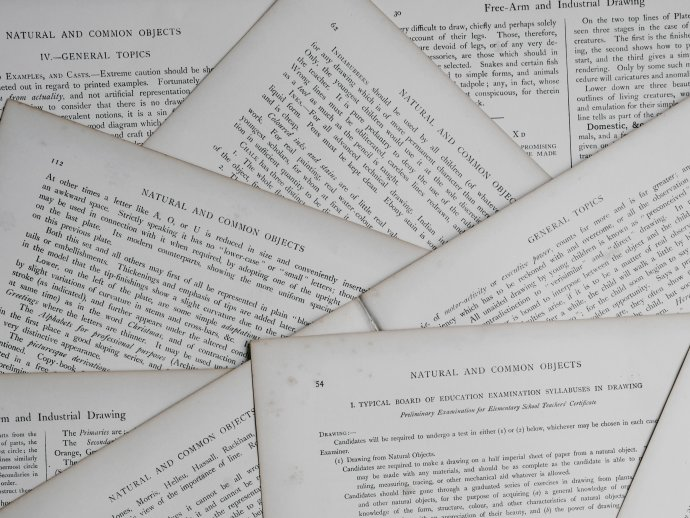 Photo of overlapping piles of papers