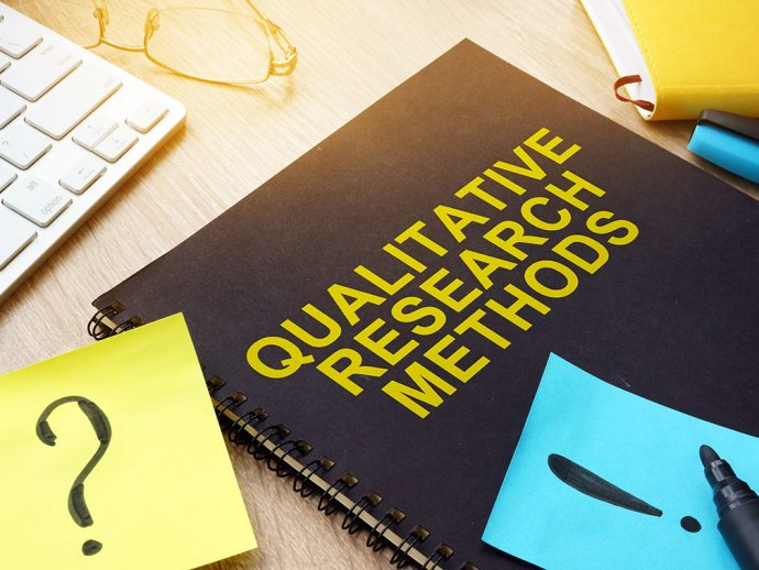 """Picture of a notebook with """"qualitative research method"""" written on the cover"""