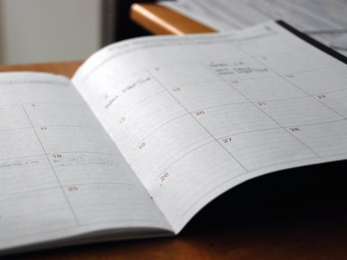 Photo of a diary laying open, with only one or two things written for the whole month