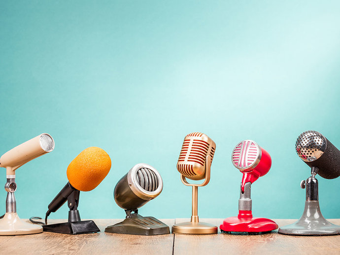 Picture of several microphones lined up together