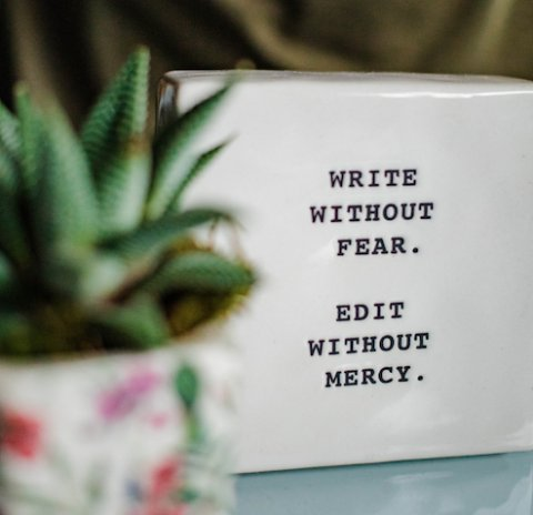 """photo of a tablet engraved with the words """"Write without fear, edit without mercy"""""""