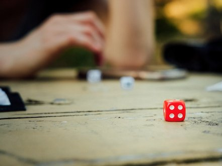 Photo of a tabletop where dice games are being played