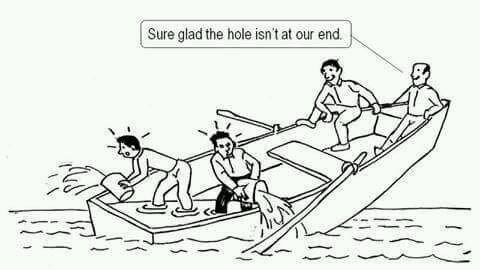 """Picture shows a cartoon boat with four people in it, sinking at one end and the two people at the other end saying """"sure glad the hole isn't at our end"""""""